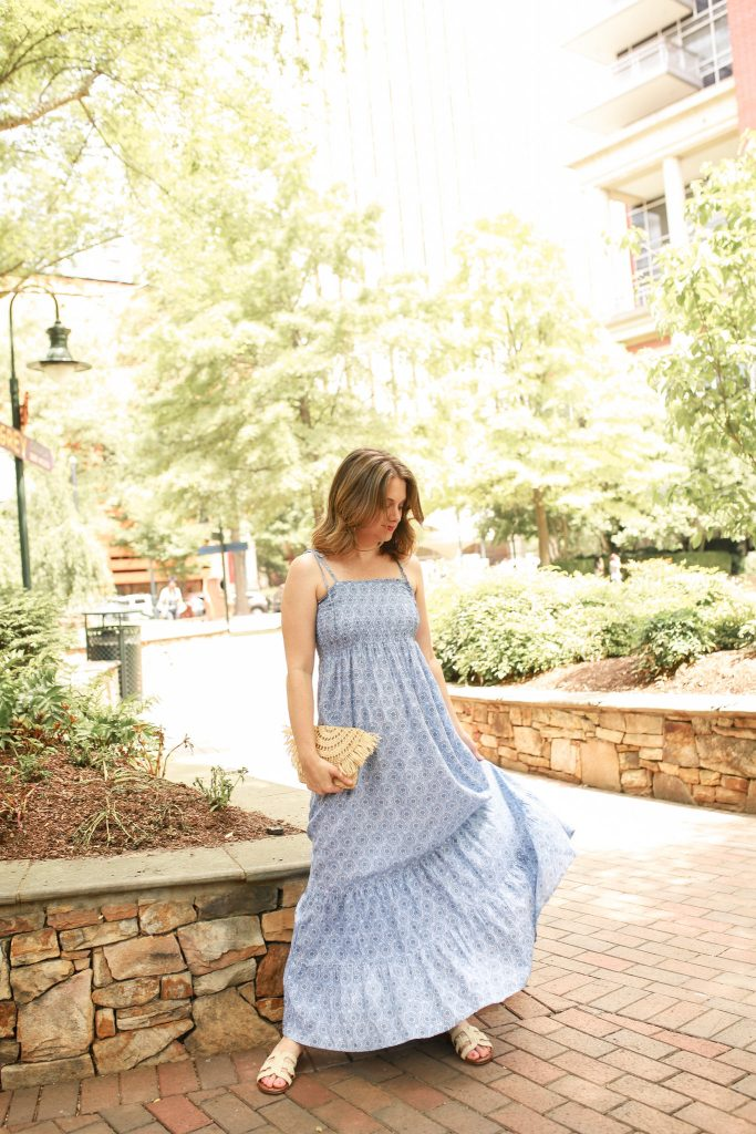 Maggie is wearing a smocked maxi dress
